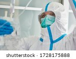 Doctor In Protective Clothing...