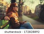 Young Woman Using A Smart - Fine Art prints