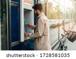 Young Bearded Man Using Atm...