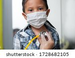 Child Wearing A Medical Mask T...