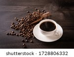 Small photo of Coffee beans and hot coffee on the table