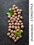 Whole Nutmeg On Black Stone...