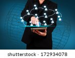 businessman holding a tablet... | Shutterstock . vector #172934078
