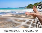 Woman Feet In Hammock On The...