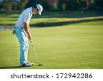 Golf Man Putting On Green For...
