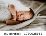 Newborn Baby Sleeps Sweetly In...