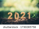 Small photo of Happy New Year 2021 social media video.2020-2021 change background new year resolution concept.wood text on ground.Perfect for your invitation or office card