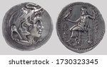 Small photo of Aureus (Coin), Obverse: Ηead of Alexander the Great with horn, clad in elephant's scalp and aegis. Reverse: Zeus seated left on throne. In right hand eagle. In left hand sceptre.