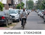 A Man Riding On His Cycle On...