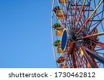 Ferris Wheel On A Background O...