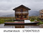 Rural landscape view of the La Cocha lagoon with motorboats and charming chalets near Pasto, Nariño Colombia