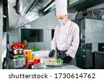 Small photo of Food delivery in the restaurant. The chef prepares food in the restaurant and packs it in disposable dishes