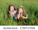 Two Little Girls Sit In The...