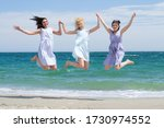 Three Young Laughing Girls In...