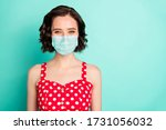 Small photo of Close up portrait of fascinating young wonderful lady posing in front of camera show covid-19 self-isolation wear fabric mask isolated with teal background