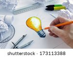 Designer Drawing A Light Bulb ...