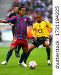 Small photo of Paris, FRANCE - May 17, 2006: Ronaldinho and Gilberto Silva in action during the UEFA Champions League final 2005/2006 FC Barcelona v Arsenal FC at the Stade de France.