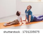 Dad Son Do Sport At Home. The...
