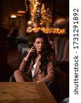 stylish business girl sitting...   Shutterstock . vector #1731291892