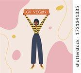 go vegan sign with black woman... | Shutterstock .eps vector #1731341335