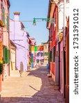 alleyway with colorful facades... | Shutterstock . vector #1731391012