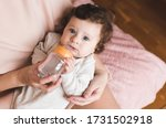 Funny Baby Holding Bottle With...