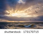 Sunset Over Water With Wave...