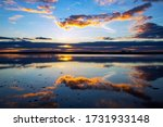 Sunset And Clouds Reflected In...