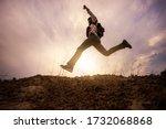 Hiker Jumping Cheerful...