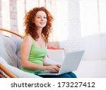 young beautiful woman using a... | Shutterstock . vector #173227412