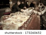 wineglasses on bar counter with ... | Shutterstock . vector #173260652