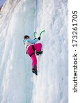 man climbing frozen waterfall | Shutterstock . vector #173261705