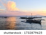 Traditional asian wooden outrigger close up during sunset