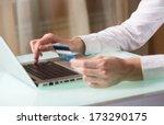 man's hand entering data using...   Shutterstock . vector #173290175