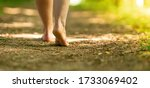 Bare Feet Of A Woman Walking...