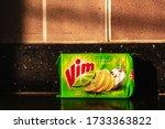Small photo of Mumbai, Maharashtra, India - December 2019: The bright green packaging of a Vim dishwash soap bar inside a kitchen.