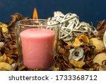 A Pink Scented Candle  Burns...