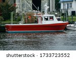 An Old Boat Docked In The...