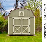 Small photo of American style wooded shed. A shed is typically a simple, single-story roofed structure in a back garden or on an allotment that is used for storage, hobbies, or as a workshop. Exterior view
