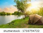 Fishing Camp On A River Bank At ...