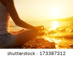 hand of a woman meditating in a ... | Shutterstock . vector #173387312