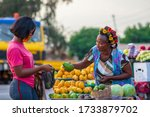 A Young African Buying Fruits...