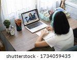 girl studying homework online... | Shutterstock . vector #1734059435