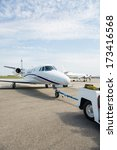private jet being towed by an... | Shutterstock . vector #173416568