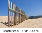 wooden fence to hold sand dunes in Cadiz. Andalusia, Spain