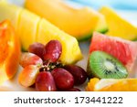 Close up of fresh tropical fruits and berries - stock photo