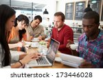 Stock photo customers in busy coffee shop 173446028