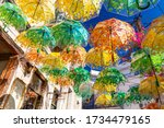 street decorated with umbrellas ... | Shutterstock . vector #1734479165