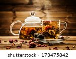teapot and glass cup with... | Shutterstock . vector #173475842