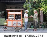 Street Food Vendor Handing A...